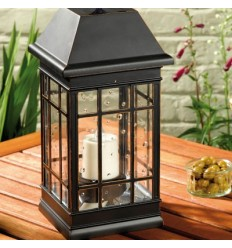 Solar lantern with candle